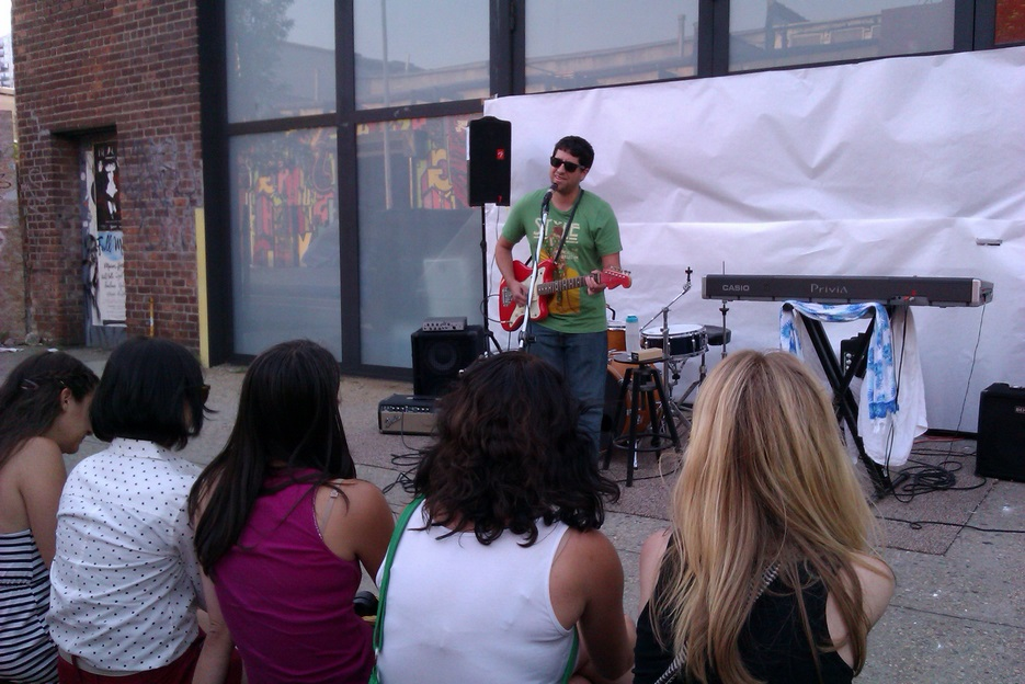 Alan Cohen performs in front of Kinfolk Studios in Brooklyn on June 21, 2013