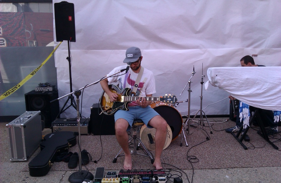 Daniel Harris performing in front of Kinfolk Studios in Brooklyn on June 21st, 2013