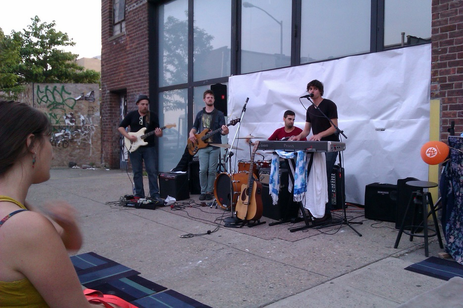 Matt Nakoa performs in front of Kinfolk Studios in Brooklyn on June 21, 2013
