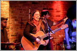 Casey Dinkin singing at the Leave A Lasting Mark Concert Series Van Morrison Tribute Show, on 2/9/2012 at The Bitter End in NYC. Photo by Manish Gosalia, courtesy of www.caseydinkin.com