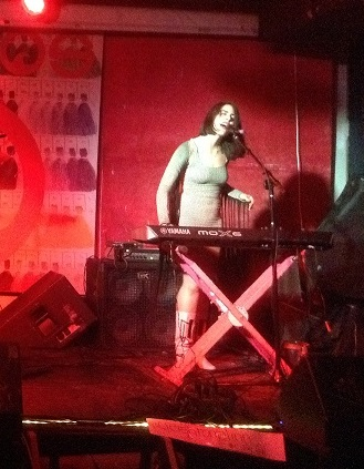 Janna Pelle sings and plays keyboard at her Album Release concert at Pianos, for her latest record,