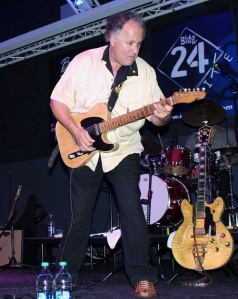 Arlen playing guitar at Building 24 in October 2014
