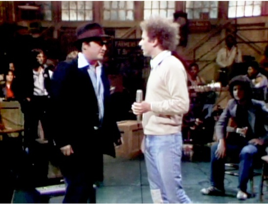 John Belush (Left), SNL Host (Middle), and Arlen Roth (right) on the set of SNL, 1978