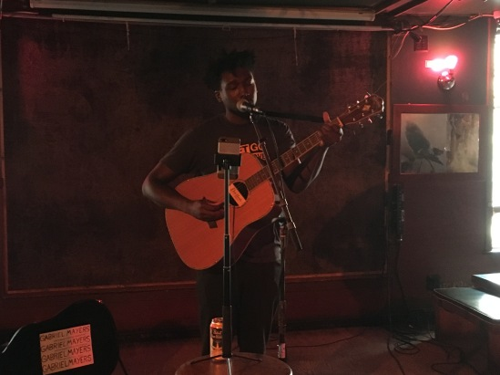 Gabriel Mayers performs on acoustic guitar at Pianos, Oct. 2017