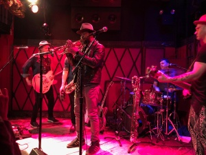Maurice Brown (trumpet player) onstage with Jamie McLean, his band, and Steve Salcedo (behind Maurice)